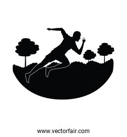 silhouette of athletic man running in the camp