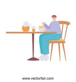 man in the restaurant eating and drinking alone because of social distancing restrictions, covid 19 pandemic