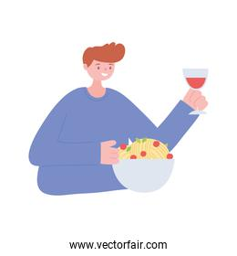 man eating and drinking alone because of social distancing restrictions, covid 19 pandemic