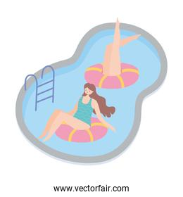 summer time girls in pool with floats vacation tourism