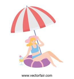 summer time beach girl sitting on float with umbrella vacation tourism