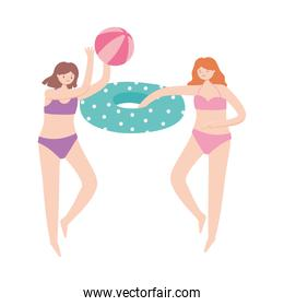 summer time vacation tourism girls playing with beach ball and float