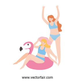 summer time vacation tourism young women with flamingo float and swimsuits