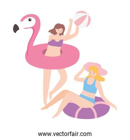 summer time women on inflatable and flamingo float with ball