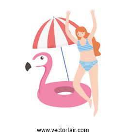 summer time beach vacation woman with umbrella and flamingo float rubber rings