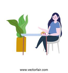 restaurant social distancing, woman eating fruits and bread alone in table, prevention covid 19 coronavirus