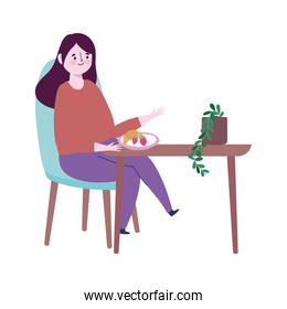 restaurant social distancing, woman eating fruits in table, prevention covid 19 coronavirus