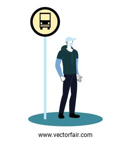 man with mask on bus stop