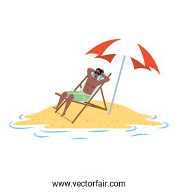 afro man relaxing on the beach seated in chair and umbrella