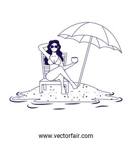young woman relaxing on the beach seated in chair and umbrella