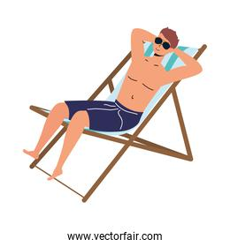 man wearing swimsuit seated in beach chair