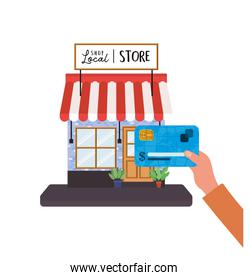 hand holding credit card in front of local store vector design
