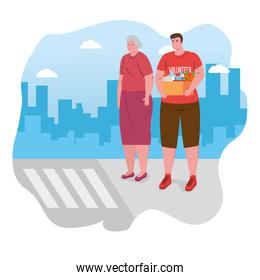 old woman with man volunteer holding donation box, charity and social care concept