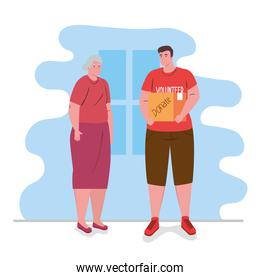 old woman with man volunteer holding donation box, charity and social care donation concept