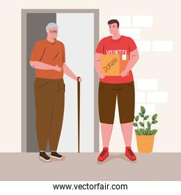 old man with man volunteer holding donation box, charity and social care donation concept
