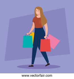 happy woman carrying shopping bags, young woman holding shopping bags