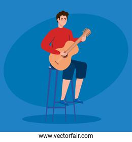 young man playing guitar sitting a chair