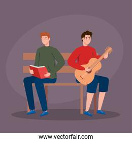 men sitting in park chair, young man playing guitar and man reading book