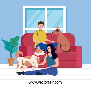 young couple in living room with dogs pet