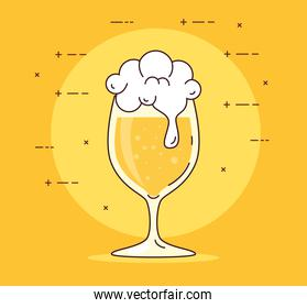 cup glass of beer with froth on yellow background