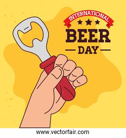 international beer day, august, with hand holding a bottle opener