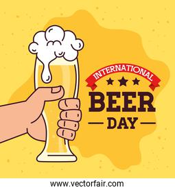 international beer day, august, hand holding a glass of beer