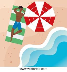 view aerial, man afro in shorts lying down, tanning on towel, with umbrella, summer vacation season