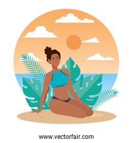 woman afro with swimsuit sitting in the beach, holiday vacation season