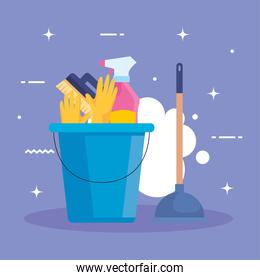 set of cleaning supplies in bucket