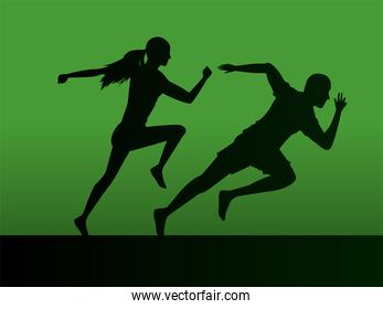 silhouettes of athletics couple running