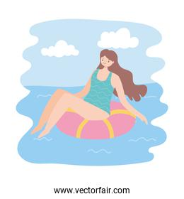 girl sunbath on ring in the swimming pool, summer vacations travel concept