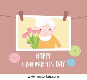 happy grandparents day, hanging photo with granny holding flowers cartoon card