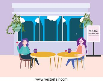 social distancing restaurant or a cafe, two single women with cups of coffee keep distance at the tables, covid 19 coronavirus, new normal life