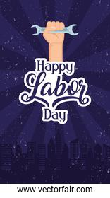 happy labor day celebration with hand lifting wrench