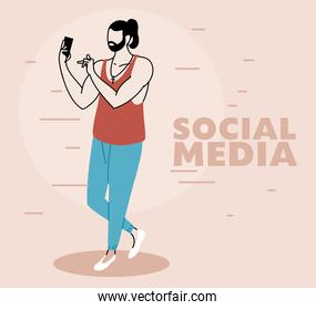 man with cell phone in hand checking social networks