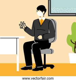 businessman wears mask and keeps distance in office