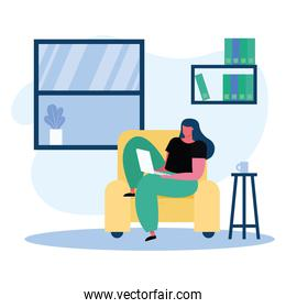 young woman using laptop working in the livingroom