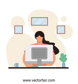 young woman using desktop working in the house