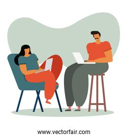 young couple using laptops working in the house