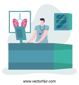 professional male doctor with stethoscope using desktop