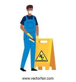 man afro worker of cleaning service wearing medical mask, with caution sign wet floor, on white background