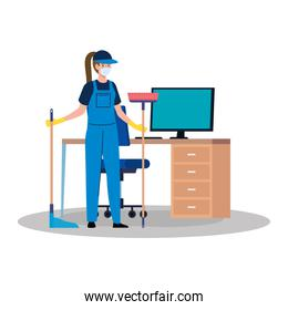 woman worker of cleaning service wearing medical mask, with broom and housekeeping picker in the office
