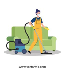 woman worker of cleaning service wearing medical mask, vacuuming the furniture, on white background