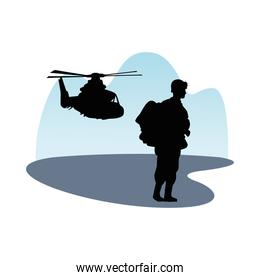 soldier military standing with helicopter silhouette