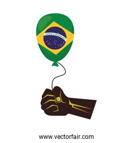 hand lifting balloon helium with brazil flag country
