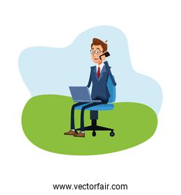 elegant businessman calling with smartphone using laptop seated in chair