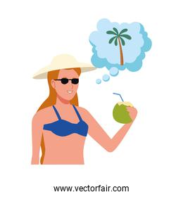 young woman wearing swimsuit drinking coconut cocktail thinking in palm