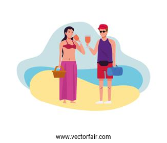 young couple wearing beach suits drinking cocktails