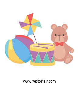 isolated teddy bear with drum ball and pinwheel