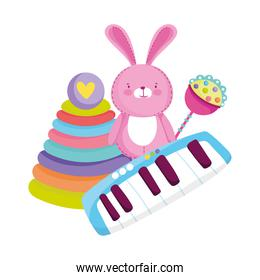 toys object for small kids to play cartoon pyramid, pink rabbit and piano